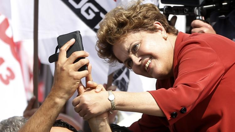 Brazil's President and PT presidential candidate Rousseff poses for a selfie with a supporter during a campaign rally in Sao Bernardo do Campo