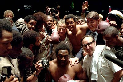 (Clockwise from top center) Director/writer/producer Michael Mann is flanked by Will Smith as Ali, Jon Voight as Howard Cosell, Ron Silver as Angelo Dundee, Charles Shufford as George Foreman, Jeffrey