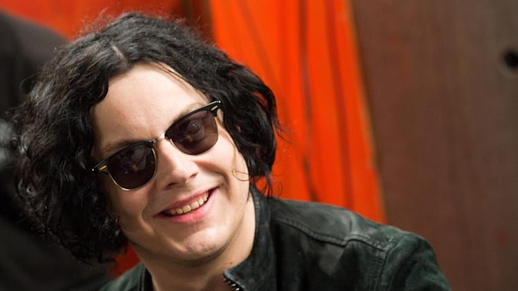"FILE - In this June 24, 2011 file photo, Jack White signs copies of the record he made with Stephen Colbert in New York. The former White Stripe has released his first solo album, ""Blunderbuss."" (AP Photo/Charles Sykes, File)"