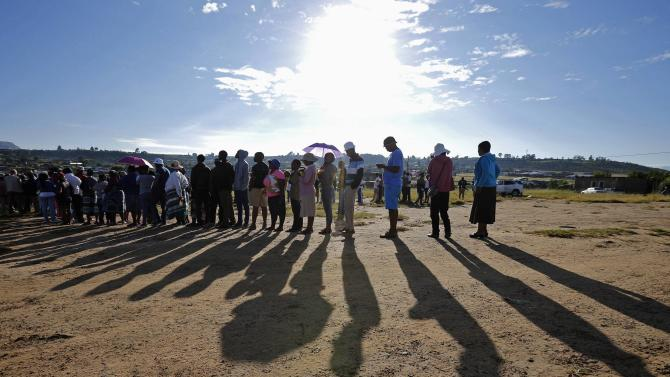 Locals wait to cast their votes during Lesotho's national elections in Magkhoakhoeng village, outside the capital Maseru