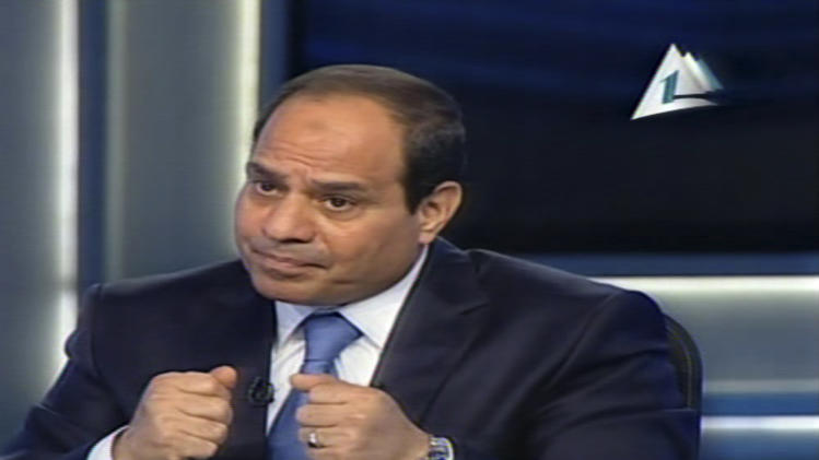 FILE - In this Tuesday, May 6, 2014 file image made from video broadcast on Egypt's State Television, Egypt's retired Field Marshal Abdel-Fattah el-Sissi speaks during an interview in a nationally televised broadcast in Cairo, Egypt. El-Sissi, the former military chief who removed Egypt's elected Islamist president and is poised to assume the post in elections this month, said Sunday, May 11, that he has plans to make improvements in people's living conditions within two years but will step down if they rise up against him. (AP Photo/Egypt's State Television, File)