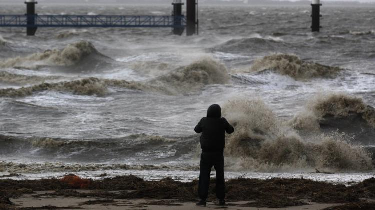 A man takes pictures of the North Sea near the town of Emde
