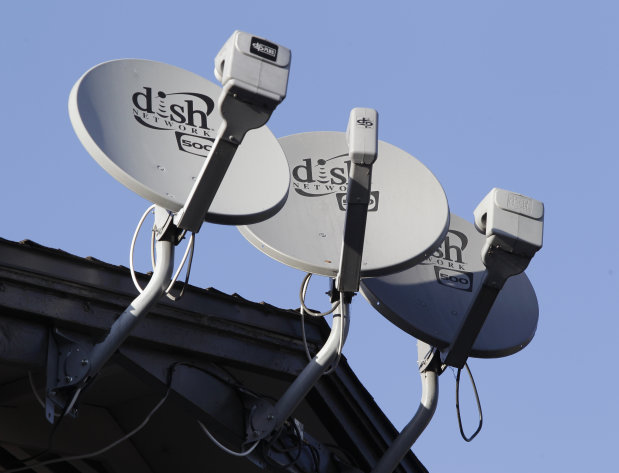FILE - In this Feb. 23, 2011 file photo, three Dish Network satellite dishes are shown at an apartment complex in Palo Alto, Calif. Dish Network Corp., the nation's second-largest satellite TV broadcaster, on Monday May 2, 2011, reported that its first-quarter net income more than doubled, helped by a patent settlement with TiVo Inc.