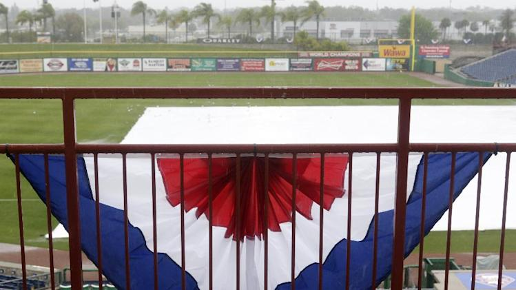 Rain falls on the stadium before a spring exhibition baseball game between the Philadelphia Phillies and the Baltimore Orioles was canceled in Clearwater, Fla., Monday, March 17, 2014