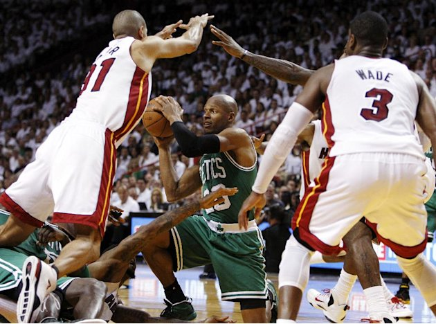 File - In this June 5, 2012, file photo, Boston Celtics' Ray Allen (20) looks to pass the ball as Miami Heat's Shane Battier (31) and Dwyane Wade (3) defend during the second half of Game 5 in their N