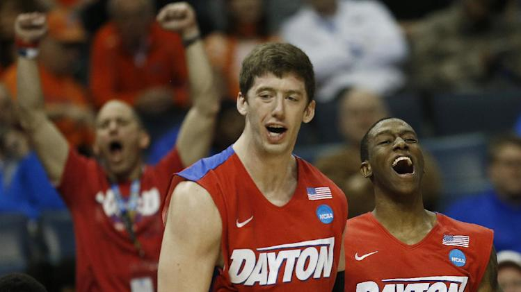 Dayton's Jordan Sibert (24) and Matt Kavanaugh (35) celebrate play against Stanford during the second half in a regional semifinal game at the NCAA college basketball tournament, Thursday, March 27, 2014, in Memphis, Tenn. (AP Photo/John Bazemore)