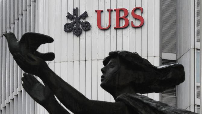 FILE - The March 19, 2012 file photo shows the logo of Swiss bank UBS  in Zurich, Switzerland. A first-quarter net profit of US$ 1 billion thanks to strong investment banking and wealth management sent shares in Swiss bank UBS AG up 5 percent Tuesday morning, April 30, 2013, on the Swiss stock exchange. The result posted by Switzerland's biggest bank, headquartered in Zurich and Basel, Switzerland, caused shares to jump to 16.5 francs soon after trading began. (AP Photo/Keystone, Steffen Schmidt)