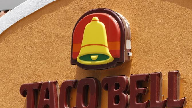 FILE - This Wednesday, June 6, 2012, file photo shows a Taco Bell restaurant in Richmond, Va. After a hoax had residents of Betlhel, Alaska thinking they would soon be getting Taco Bell, executives for the chain restaurant have arranged to fly enough ingredients from Anchorage to make 10,000 free tacos for a feast on Sunday, July 1, 2012. The city of 6,200 people is about 40 miles inland from the Bering Sea in far western Alaska, and the closest fast food other than a Subway sandwich shop is in Anchorage, 400 miles and a $500 round-trip plane ticket away. (AP Photo/Steve Helber, File)