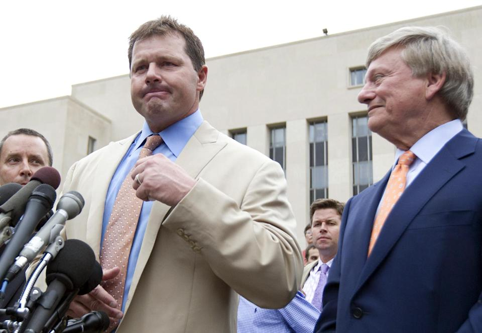 Former Major League Baseball pitcher Roger Clemens speaks to the media outside federal court in Washington, Monday, June 18, 2012, as his attorney Rusty Hardin listens, after Clemens was acquitted on all charges by a jury that decided that he didn't lie to Congress when he denied using performance -enhancing drugs. (AP Photo/Manuel Balce Ceneta)