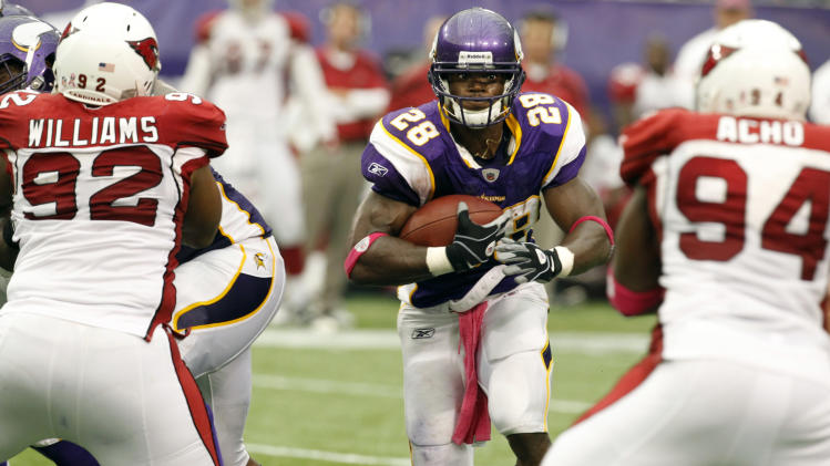 Minnesota Vikings running back Adrian Peterson (28) carries the ball during the second half of an NFL football game against the Arizona Cardinals, Sunday, Oct. 9, 2011, in Minneapolis. (AP Photo/Genevieve Ross)