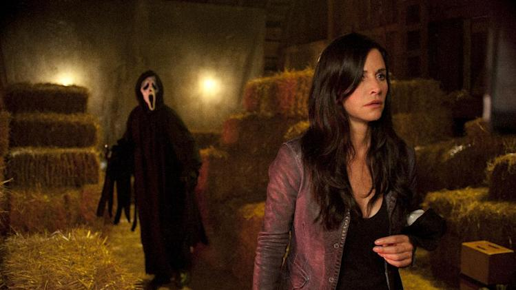 "In this publicity image released by The Weinstein Company, Courteney Cox is shown in a scene from the horror film ""Scream 4."" The MTV network says it will produce a pilot for a TV-series adaptation of the wildly popular slasher films. The series would reinvent the horror-comedy franchise that began with the original release in 1996 and spawned three sequels, the most recent in 2011. The films' original director, Wes Craven, is in discussions to direct the one-hour pilot, MTV said.  The ""Scream"" series is planned to debut in summer 2014.  (AP Photo/Dimension Films-The Weinstein Company, Gemma La Mana)"