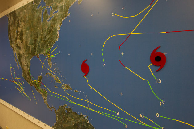 A map at the National Hurricane Center in Miami shows the location of tropical weather systems Thursday, Sept. 6, 2012. Hurricane Leslie is south of Bermuda. Tropical Storm Michael is brewing in the mid Atlantic ocean. In the Caribbean Sea, the monsoon trough is producing showers and thunderstorms over Colombia, Venezuela and the southwestern Caribbean Sea. Farther north, an area of low pressure off the coast of Alabama and western Florida Panhandle is producing showers and thunderstorms. This system has a low chance of development into a tropical cyclone. (AP Photo/J Pat Carter)