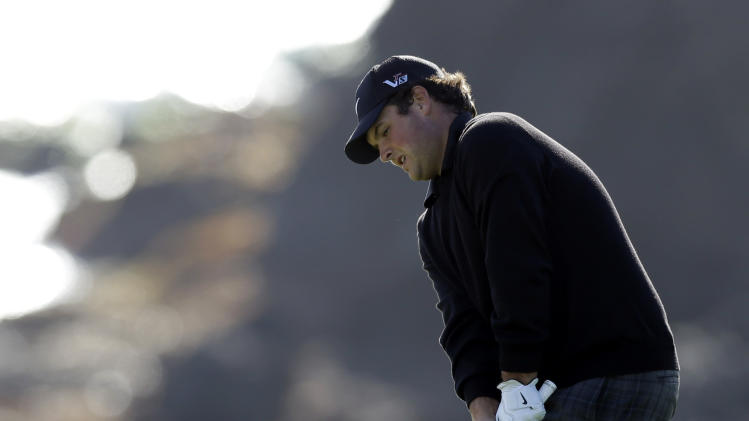 Patrick Reed chips onto the green on the eighth hole of the Pebble Beach Golf Course during the second round of the AT&T Pebble Beach Pro-Am golf tournament on Friday, Feb. 8, 2013, in Pebble Beach, Calif. (AP Photo/Ben Margot)