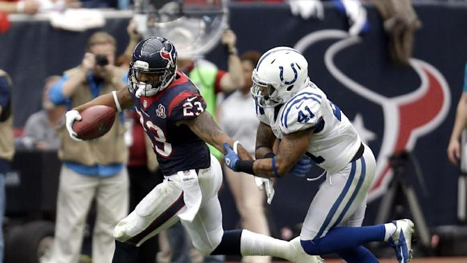 Houston Texans running back Arian Foster (23) is tackled by Indianapolis Colts free safety Antoine Bethea (41) in the third quarter of an NFL football game on Sunday, Dec. 16, 2012, in Houston. (AP Photo/Eric Gay)