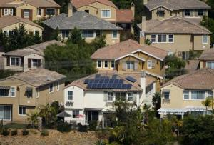 A home with solar panels on its roof is shown in a residential neighborhood in San Marcos