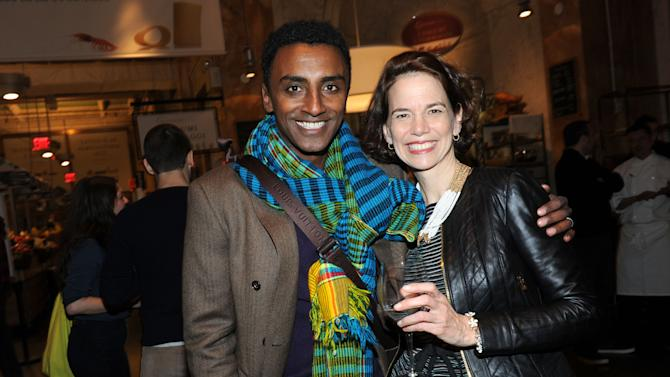 FOOD & WINE editor in chief Dana Cowin, right, and chef Marcus Samuelsson celebrate the Mario Batali guest-edited April issue of FOOD & WINE during a party at Eataly in New York, Wednesday, March 6, 2013.  (Photo by Diane Bondareff/Invision for FOOD & WINE/AP Images)
