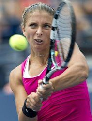Sara Errani of Italy hits a return to Angelique Kerber of Germany during their women&#39;s singles match at the 2012 US Open tennis tournament in New York. Errani won 7-6 (7/5), 6-3