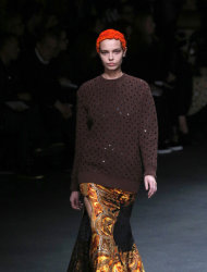 A model wears a creation by designer Riccardo Tisci for Givenchy as part of his Fall/Winter 2013-2014 ready to wear collection, in Paris, Sunday, March, 3, 2013. (AP Photo/Christophe Ena)