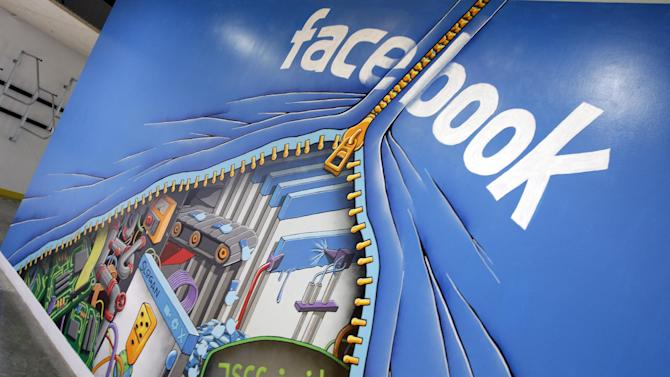 This Feb. 8, 2012 photo shows a mural at Facebook headquarters in Menlo Park, Calif. Intruders recently infiltrated the systems running the world's largest online social network but did not steal any sensitive information about Facebook's more than 1 billion users, according to a blog posting Friday, Feb. 15, 2013, by the company's security team. (AP Photo/Paul Sakuma)