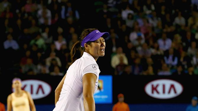 China's Li Na reacts after falling during her match against Victoria Azarenka of Belarus in the women's final at the Australian Open tennis championship in Melbourne, Australia, Saturday, Jan. 26, 2013. (AP Photo/Ryan Pierse,Pool)