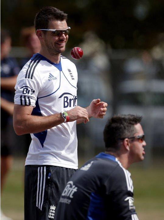 England cricket team bowler Anderson laughs as he talks with team mate Pietersen during a training session at the University Oval in Dunedin