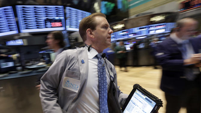 In this Monday, April 29, 2013, photo, Trader Michael Smyth rushes across the floor of the New York Stock Exchange. Concerns over the state of the U.S. and China economies, the world's two biggest, weighed on markets Thursday May 2, 2013 despite widespread expectations that the European Central Bank will cut interest rates to a new low later. (AP Photo/Richard Drew)