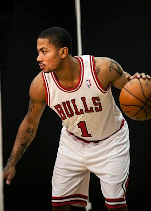 Chicago Bulls' Derrick Rose poses for pictures during the NBA basketball team's media day, Monday, Oct. 1, 2012, in Deerfield, Ill. (AP Photo/Charles Cherney)