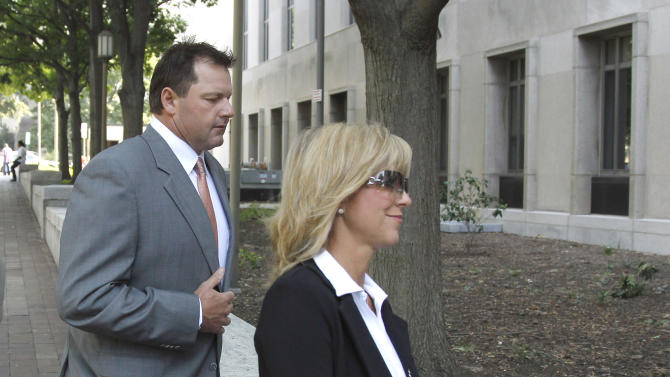 Former Major League Baseball pitcher Roger Clemens, left, with his wife Debbie Clemens, arrives at federal court in Washington, Thursday, July 7, 2011, for his trial on charges of lying to Congress in 2008 when he denied ever using performance-enhancing drugs. (AP Photo/Alex Brandon)