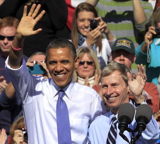 President Barack Obama, accompanied by New Hampshire Gov. John Lynch, waves to a crowd after being introduced Lynch, D-N.H. during a campaign stop, Thursday, Oct. 18, 2012, in Manchester, N.H. (AP Photo/Jim Cole)