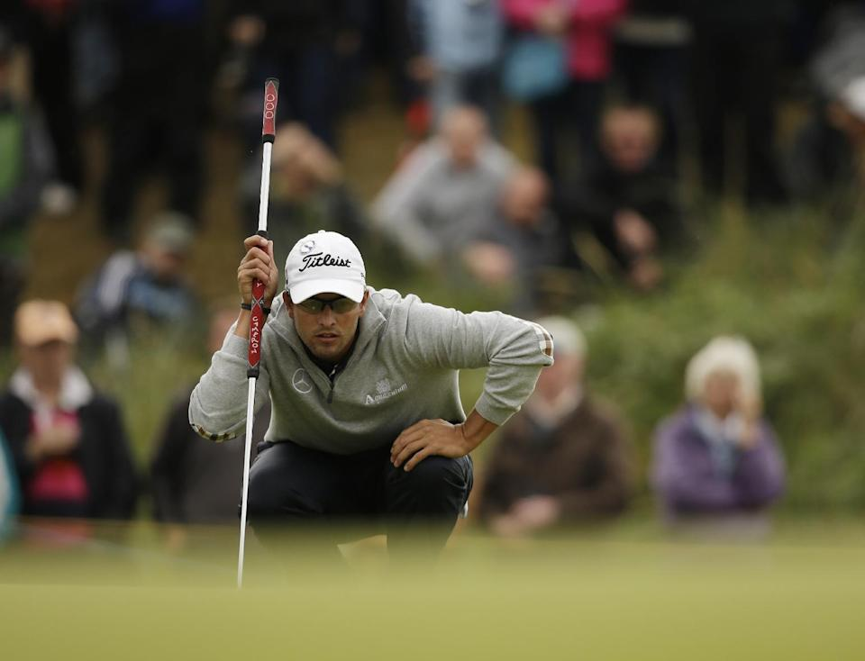 Adam Scott of Australia lines up a putt on the sixth green at Royal Lytham & St Annes golf club during the second round of the British Open Golf Championship, Lytham St Annes, England, Friday, July 20, 2012. (AP Photo/Tim Hales)