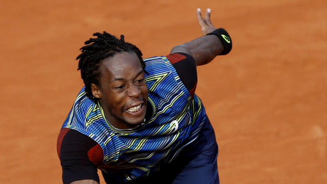 France's Gael Monfils returns the ball to Czech Republic's Tomas Berdych during their first round match for the French Open tennis tournament at the Roland Garros stadium Monday, May 27, 2013 in Paris. (AP Photo/Petr David Josek)