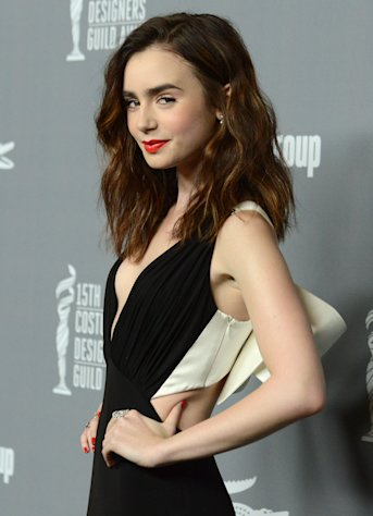 Lily Collins arrives at the 15th Annual Costume Designers Guild Awards at The Beverly Hilton Hotel on Tuesday, Feb. 19, 2013 in Beverly Hills. (Photo by Jordan Strauss/Invision/AP)