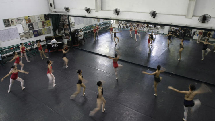In this photo taken Nov. 25, 2012, students practice during a class at Ballet Manila in the Philippine capital. Aside from well-off students, the school picks scholars among kids living in slum areas of Manila and enroll them at their dance scholarship program where they are given a monthly stipend. (AP Photo/Aaron Favila)