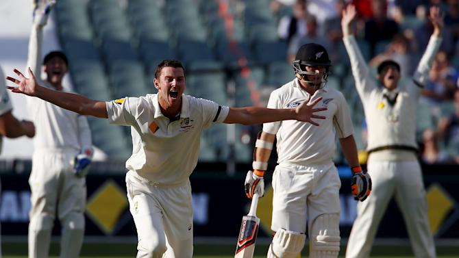 Australia's Josh Hazlewood appeals unsuccessfully with team mates for LBW to dismiss New Zealand's Tom Latham during the second day of the third cricket test match at the Adelaide Oval, in South Australia