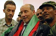 National Transitional Council (NTC) fighters gather around Libya's interim leader Mustafa Abdel Jalil (C) wrapped with the revolution flag. (AFP Photo/Abdullah Doma)