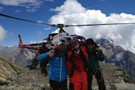 Image provided by Simrik Air shows rescuers assisting a foreigner who was injured following an avalance at the Mount Manaslu base camp in Gorkha Districtst on September 23. Rescuers have scaled down a search for two French climbers and a Canadian missing in a Nepal avalanche which killed at least nine people attempting to scale one of the world's highest peaks