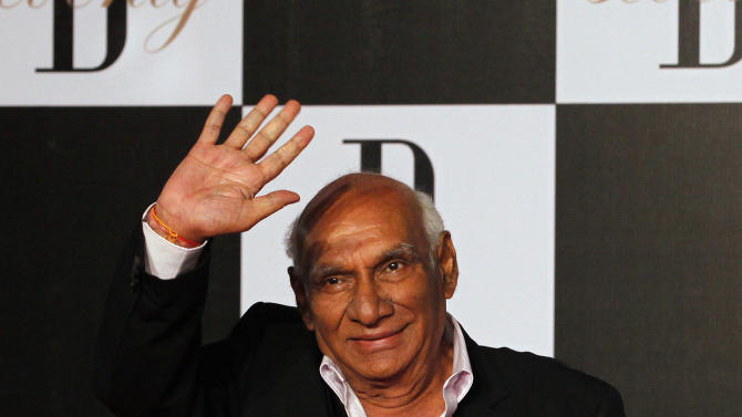 In this photo taken Oct. 10, 2012, Bollywood producer and director Yash Chopra arrives for a party on the eve of Bollywood actor Amitabh Bachchan's 70th birthday in Mumbai, India. Bollywood movie mogul Yash Chopra died Sunday, Oct. 21, 2012 in Mumbai more than a week after he contracted dengue fever, a doctor said. He was 80. (AP Photo/ Rajanish Kakade)