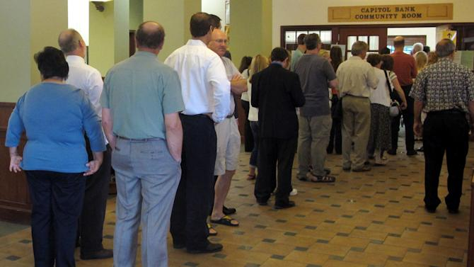 Voters line up at a polling place Tuesday, June 5, 2012, in Madison, Wis. Wisconsin Republican Gov. Scott Walker faces Democratic challenger Tom Barrett in a special recall election. (AP Photo/Scott Bauer)