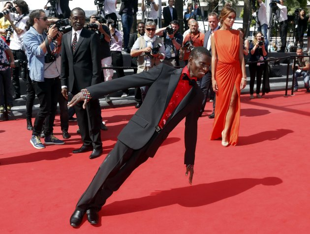"Cast member Souleymane Deme performs on the red carpet as he arrives for the screening of the film ""Grigris"" in competition during the 66th Cannes Film Festival"