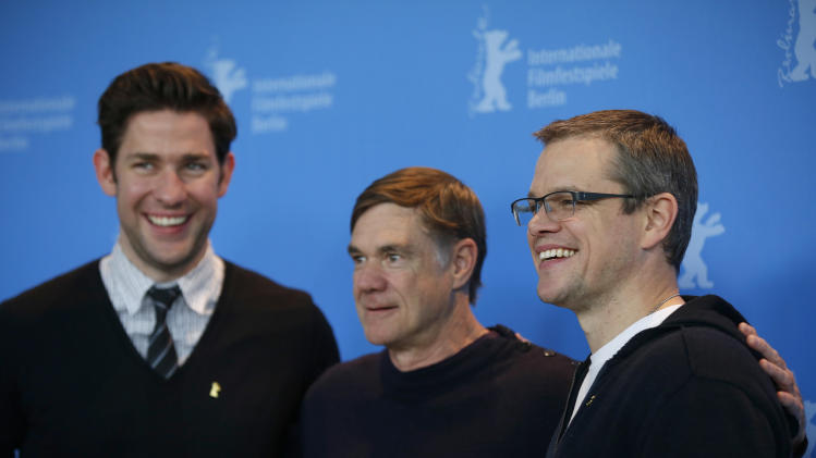 Actor John Krasinski, director Gus Van Sant and actor Matt Damon pose at the photo call for the film Promised Land at the 63rd edition of the Berlinale, International Film Festival in Berlin, Friday, Feb. 8, 2013. (AP Photo/Gero Breloer)