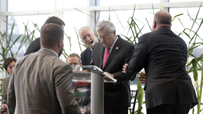Iowa Gov. Terry Branstad is steadied during a speaking event at DuPont Pioneer, Monday, Jan. 26, 2015, in Johnston, Iowa. Branstad will spend the night at a hospital with flu-like symptoms. (AP Photo/The Des Moines Register, Zach Boyden-Holmes)  MANDATORY CREDIT
