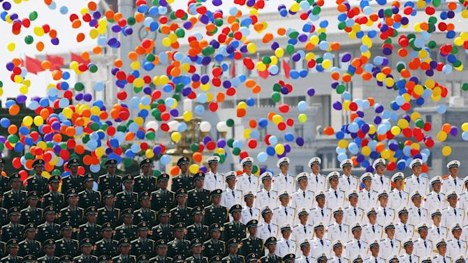 Colourful balloons are released at the end of the military parade marking the 70th anniversary of the end of World War Two, in Beijing