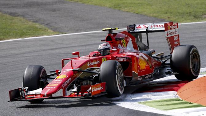 Ferrari Formula One driver Raikkonen of Finland takes a curve during the first free practice session for the Italian F1 Grand Prix in Monza