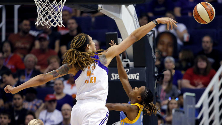 FILE - In this July 2, 2014, file photo, Phoenix Mercury center Brittney Griner (42) blocks the shot of Chicago Sky guard Jamierra Faulkner during the first half of a WNBA basketball game in Phoenix. A person close to the situation says Griner has won the WNBA defensive player of the year award. The person says Griner will receive the award Friday night, Aug. 22, 2014, in Phoenix before the Mercury face Los Angeles in the first game of the Western Conference semifinals. (AP Photo/Matt York, File)