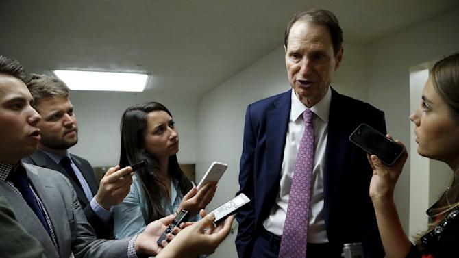 Wyden speaks with reporters as he arrives for the weekly Democratic Caucus policy luncheon at the U.S. Capitol in Washington