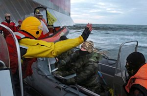 A Russian Coast Guard officer points a knife at a Greenpeace …