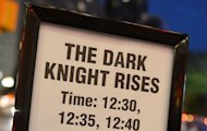 "<p>A signboard outside a Midnight Premiere showing of the ""The Dark Knight Rises"" on Thursday. At least 10 people were killed and several wounded early Friday when two gunmen wearing gas masks and body armor opened fire at a crowded cinema premiere in the US city of Aurora, media reported.</p>"