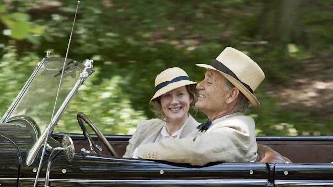"""This film image released by Focus Features shows, from left, Laura Linney as Daisy, and Bill Murray as Franklin D. Roosevelt in a scene from """"Hyde Park on Hudson."""" (AP Photo/Focus Features, Nicola Dove)"""