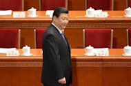 Incoming Chinese president Xi Jinping arrives at the opening session of the National People's Congress in Beijing on March 5, 2013. Inflation is a key issue for the ruling Communist Party as it brings with it the risk of popular discontent over rising prices and the threat of social unrest