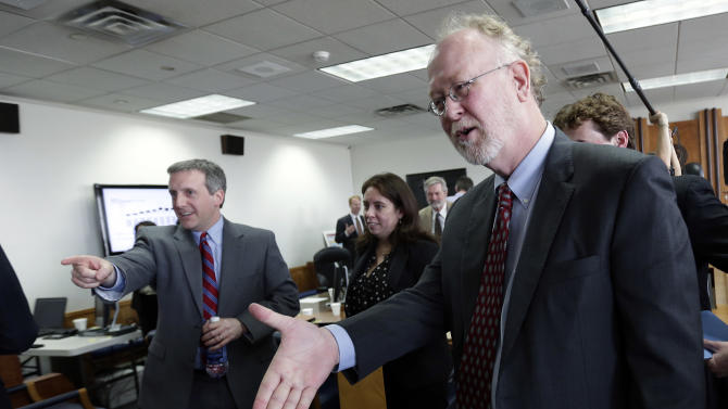 Attorney David Thompson ,right, and member so his team are congratulated following a ruling in a consolidated six-lawsuit case contending the school finance system violates the Texas Constitution, Monday, Feb. 4, 2013, in Austin, Texas. State District Judge John Dietz ruled that he system Texas uses to fund public schools violates the state's constitution by not providing enough money to school districts and failing to distribute the money in a fair way. (AP Photo/Eric Gay)